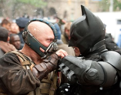(L-r) TOM HARDY as Bane and CHRISTIAN BALE as Batman in Warner Bros. Pictures'€™ and Legendary Pictures' action thriller '€œTHE DARK KNIGHT RISES,'€ a Warner Bros. Pictures release. Photo by Ron Phillips.