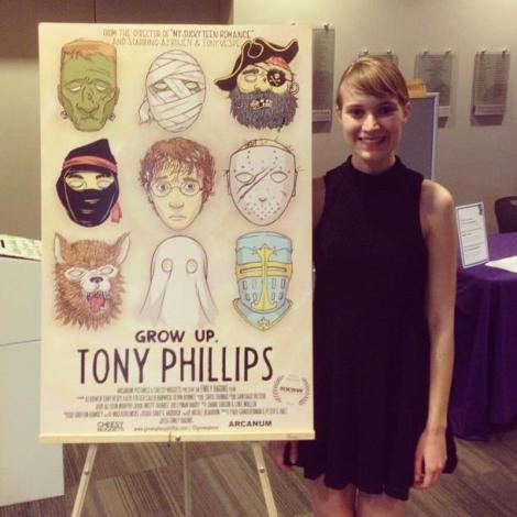 "Writer/director Emily Hagins stands next to the poster of her new film, ""Grow Up, Tony Phillips."" Courtesy of Emily Hagins."