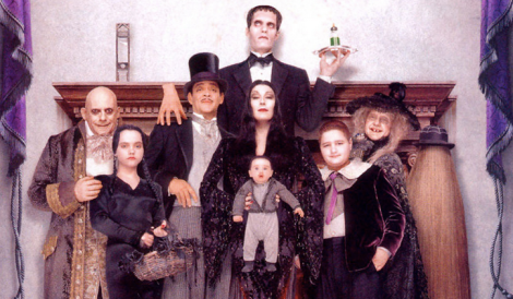 "Christopher Lloyd, Christina Ricci, Christopher Hart, Raul Julia, Anjelica Huston, Carel Struycken, Kristen Hooper, Jimmy Workman, Carol Kane and John Franklin in Barry Sonnenfeld's ""Addams Family Values."" Courtesy of Paramount Pictures."