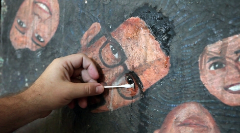 """Peter Anton paints a self-portrait in """"Almost There."""" Courtesy of Kartemquin Films."""